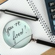 Message You're Fired on notebook with calculator, marker and magnifying glass on wooden table, closeup — Stock Photo #69356965