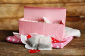Heart shaped teabag tags and box on wooden background — Stock Photo