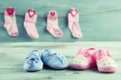 Cute toddler shoes and socks on wooden background — Stock Photo