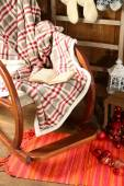 Rocking chair with plaid and book — Stock Photo