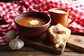 Ukrainian beetroot soup - borscht, on napkin, on wooden background — Stok fotoğraf