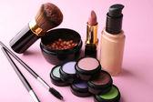 Set of decorative cosmetics on light colorful background — Stock Photo