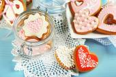 Heart shaped cookies for valentines day on plate, on color wooden background — Stock Photo