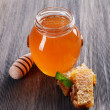 Delicious honey with honeycomb on table close-up — Stock fotografie #69480181