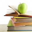 Books and apple on desk, isolated on white — Stock Photo #69480211