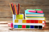 Bright school stationery on old wooden table — Foto de Stock