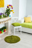 Fireplace with beautiful spring decorations in room — Stockfoto