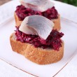 Rye toasts with herring and beets on plate close up — Stock Photo #69565677