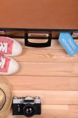 Suitcase and tourist stuff with inscription travel insurance on wooden background top view — Stock Photo
