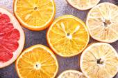 Slices of dried lemon, orange and grapefruit on metal background — Stock Photo