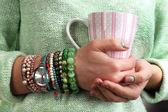 Stylish bracelets and clock on female hand close-up — Stock fotografie