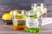 Fresh water with lemon and cucumber — Stock Photo