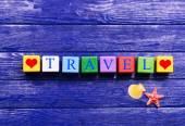Travel inscription on wooden background — Stock fotografie