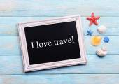 Travel inscription on wooden background — Stock Photo