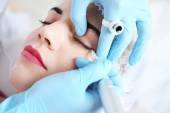 Cosmetologist applying permanent make up on eyes, close-up — Stock Photo