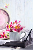 Beautiful flowers in cup — Stock Photo