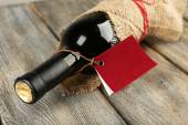 Bottle wrapped in burlap cloth — Stock Photo