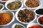 Different kinds of spices in ceramics spoons — Stock Photo
