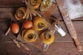 Still life of preparing pasta on rustic wooden background — Foto de Stock