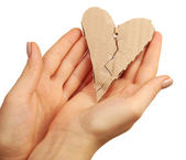 Female hands holding broken heart stitched with staples isolated on white — Stock Photo