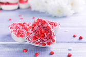 Delicious chocolate candies in heart shape on table close-up — Stock Photo