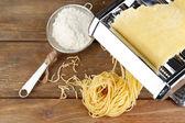 Making vermicelli with pasta machine — Stock Photo