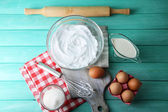 Whipped egg whites for cream on wooden table, top view — Stock Photo