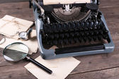 Retro typewriter on wooden table, closeup — Stockfoto