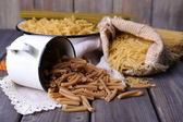 Different types of pasta in containers — Stock Photo