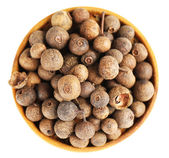 Allspice in wooden bowl, isolated on white — Stock Photo