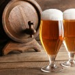 Glasses of beer on wooden background — Stock Photo #69732161