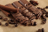Chopped chocolate on parchment — Stock Photo