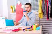 Young man fashion designer in atelier — Stock Photo