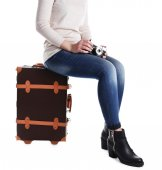 Woman sitting on suitcase — Stock Photo