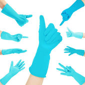 Hands in blue gloves gesturing numbers isolated on white — Stock Photo