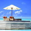 View of place for rest with sunbed and parasol in Baros Maldives — Stock Photo #69868565