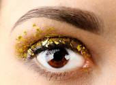 Female eye with fancy glitter makeup, macro view — Stock Photo