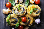 Raw pasta with cheese and vegetables on table close up — Stock Photo