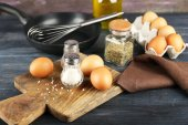 Still life with eggs and pan on wooden background — Foto de Stock