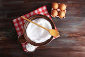 Whipped egg whites and other ingredients for cream on wooden table, top view — Stock Photo