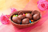 Chocolate Easter eggs on color tulle, closeup — ストック写真