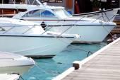 Yacht berth in ocean water in resort — Stock Photo