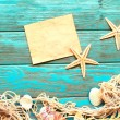 Card blank with sea stars and shells on wooden background — Stock Photo #70040903
