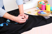 Male dressmaker drawing line — Stock Photo