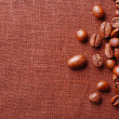 Frame of coffee beans on color sackcloth background — Stock Photo #70225113