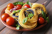 Raw pasta with cheese and vegetables on plate on table close up — Stock Photo