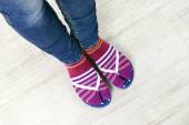 Female feet in socks with pink flip-flops — Stock Photo