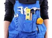Man in coveralls with tools in his pocket, closeup — Stock Photo