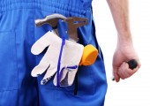 Man in coveralls with tools in his pocket isolated on white — ストック写真