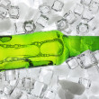 Glass bottle of beer on ice cubes background — Stock Photo #70235255
